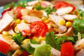 Closeup on chicken saladwith cheese and vegetables — Stock Photo