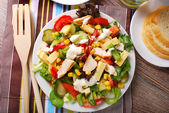 Chicken salad with cheese and vegetables — Stock Photo
