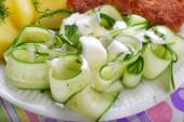 Fresh cucumber salad with sour cream and dill — Stock Photo