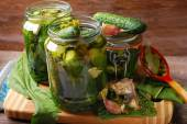Freshly made pickled cucumbers in jars — Stock Photo