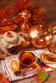 Autumn tea with spices and honey on wooden table — Stockfoto