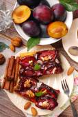 Piece of plum cake with nuts and spices — Stock Photo