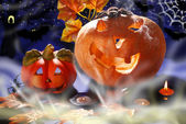 Halloween still life with pumpkins glowing in the night — Stock Photo