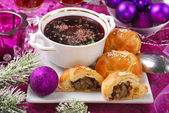 Red borscht and pastries with mushrooms for christmas — Stock Photo
