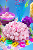 Birthday cake with pink meringues and candles — Stock Photo