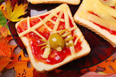 Funny sandwich with spider web for halloween — Stock Photo