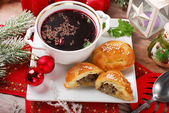 Red borscht and pastries for christmas eve — Stock Photo