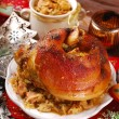 Pork knuckle with sauerkraut for christmas dinner — Stock Photo #56546863