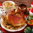 Pork knuckle with sauerkraut for christmas dinner — Stock Photo #56546879