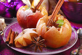 Baked apples with nuts and raisins for christmas — Stock Photo