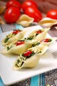 Pasta shells stuffed with spinach — Stock Photo