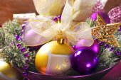 Christmas decoration in purple and golden colors — Stock Photo