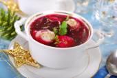 Red borscht with ravioli for christmas — Stock Photo