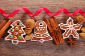 Christmas wooden background with gingerbread cookies — Stock Photo
