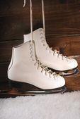 Ice skates on wooden background — Stock Photo