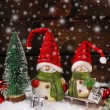 Christmas decoration with santa figurines on wooden background — Stock Photo #58622385