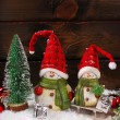 Christmas decoration with santa figurines on wooden background — Stock Photo #58622401