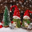 Christmas decoration with santa figurines on wooden background — Stock Photo #58622403
