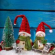 Christmas decoration with santa figurines on wooden background — Stock Photo #58622463