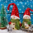Christmas decoration with santa figurines on wooden background — Stock Photo #58622465