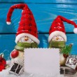 Christmas decoration with santa figurines on wooden background — Stock Photo #58622485