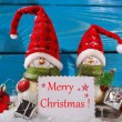 Christmas decoration with santa figurines on wooden background — Stock Photo #58622507