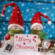 Christmas decoration with santa figurines on wooden background — Stock Photo #58622513