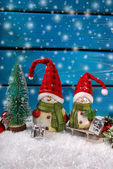 Christmas decoration with santa figurines on wooden background — Stock Photo