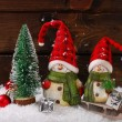 Christmas decoration with santa figurines on wooden background — Stock Photo #58664887