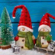Christmas decoration with santa figurines on wooden background — Stock Photo #58664921