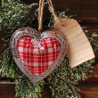 Christmas card with vintage heart and papar tag — Stock Photo #59067787