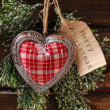 Christmas card with vintage heart and papar tag — Stock Photo #59067789