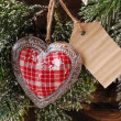 Christmas card with vintage heart and papar tag — Stock Photo #59067801