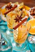 Apple and orange drink with spices for christmas  — Stock Photo