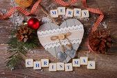Merry christmas wenskaart op houten achtergrond — Stockfoto