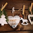 Wooden christmas decorations hanging on twine — Stock Photo #59585633