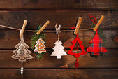 Christmas tree shaped decoration collection hanging on twine — Stock Photo