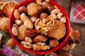 Nuts assortment in bowl on wooden table for christmas — Stock Photo