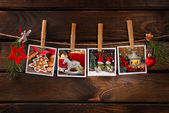 Christmas photos hanging on rope against wooden background — Stock Photo