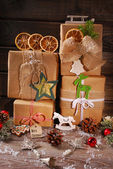 Christmas presents wrapped in eco paper — Stock Photo