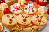 Funny christmas cookies made by kids — Stock Photo