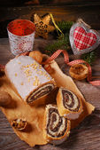 Traditional christmas poppy seed cake on wooden table — Stock Photo