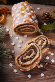 Christmas poppy seed cake with icing and snowflake sprinkles — Stock Photo
