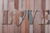 Wooden letters love with hearts — Stock Photo