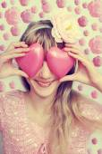 Funny girl holding hearts on eyes-vintage style — Stock Photo