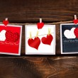 Valentines cards hanging on wooden background — Stock Photo #62668883