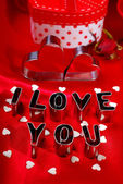 Valentines card with cookie cutters in heart and letter shape — Stok fotoğraf