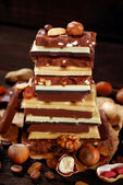 Stack of various chocolate bars — Stock Photo