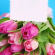 Bunch of pink tulips and blank card — Stock Photo #63946403