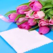 Bunch of pink tulips and blank card — Stock Photo #63946479